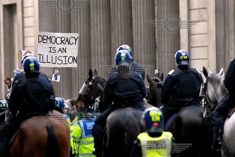 Riot police on horseback surround demonstrators outside the Bank of England as thousands of protestors descended on the City of London ahead of the G20 summit of world leaders to express anger at the economic crisis, which many blame on the excesses of capitalism.
