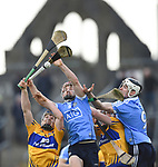 Podge Collins and David Fitzgerald of Clare in action against Niall Mc Morrow and Caolan Conway of Dublin during their National Hurling League game at Cusack Park. Photograph by John Kelly.