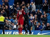 Jurgen Klopp manager of Liverpool hugs goal scorer Trent Alexander-Arnold of Liverpool during the Premier League match between Chelsea and Liverpool at Stamford Bridge, London, England on 22 September 2019. Photo by Liam McAvoy / PRiME Media Images.