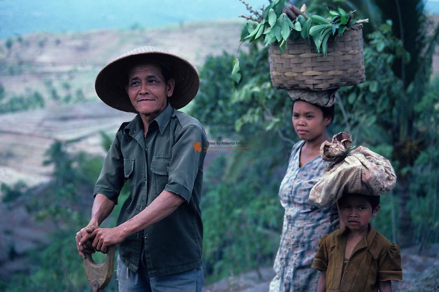 Nepali women carrying basket of fodder