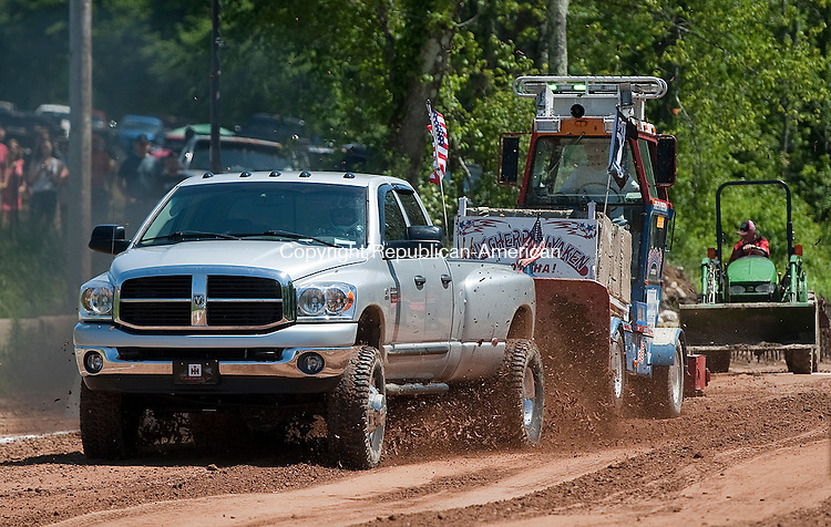 GOSHEN, CT 15 JUNE 2013--061513JS09-Rich Bergan of Wallingford in his 2008 Dodge 3500 pulls the sled 232.9 feet during the truck pull competition during the Goshen Stampede Saturday at the Goshen Fairgrounds. The stampede continues today  from 10am to 8pm. <br />   Jim Shannon Republican American