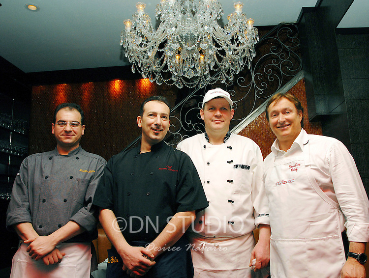 """New York, NY - April 22, 2008: (L-R) Chef at Baraonda Giuseppe Mazzeo, Chef at Bella Blu Roberto Patriarca, Cehf Daniele Perugini and Owner, Proietti Restaurant Group and Chef Enrico Proietti. Ciaobella Restaurant Brings """"The Art Of Pasta"""" To Children In Need. Owner and Chef Enrico Proietti and Executive Chef Floess show the children of the Ronald  McDonald House of NY """"The Art of Pasta"""" by teaching them about the history of Italian food and allowing them to explore a selection of pasta, preparation techniques and regional cooking styles. Afterwards, the children wil share their culinary creations with their families during a big, Italian family style meal in the elegant surroundings of Ciaobella."""