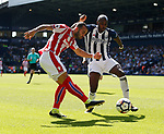 Jese of Stoke City gets in a shot past Allan-Romeo Nyom of West Bromwich Albion during the premier league match at the Hawthorn's Stadium, West Bromwich. Picture date 27th August 2017. Picture credit should read: Simon Bellis/Sportimage