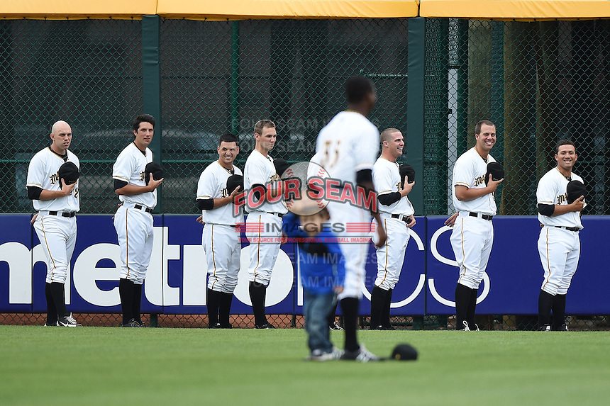 Bradenton Marauders outfielder Raul Fortunato (35) has a young fan trying to get his attention during the national anthem as the bullpen including Robby Rowland (12), Thomas Harlan (19), Kawika Emsley-Pai, Josh Smith (16), Tyler Waldron, Ryan Hafner (55), and Jhondaniel Medina (34) get a good laugh before a game against the Jupiter Hammerheads on April 17, 2014 at McKechnie Field in Bradenton, Florida.  Bradenton defeated Jupiter 2-1.  (Mike Janes/Four Seam Images)