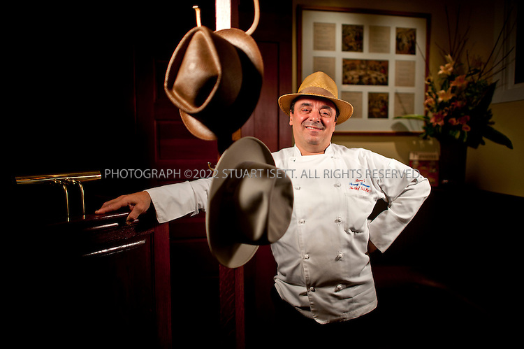 3/2/2011--Seattle, WA, USA..Chef Thierry Rautureau posing in his Seattle restaurant 'Rover's' in one of his signature hats. Rautureau is nicknamed 'The Chef In The Hat', is the chef/owner of Rover's and Luc Restaurants in Seattle, Washington. Rautureau was born in the Muscadet region of France...©2011 Stuart Isett. All rights reserved.