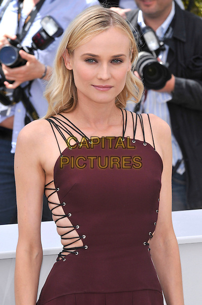 Diane Kruger.Jury photocall at the 65th  Cannes Film Festival, France 16th May 2012.half length maroon burgundy dress lace-up laces sides brown.CAP/PL.©Phil Loftus/Capital Pictures.