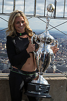 "New York, USA. 23 April 2014.  ""Miss Supercross"" Dianna Dahlgren, holds up the trophy as she promotes the motorcycle race during a visit to the Empire State Building in New York. Photo by Eduardo Munoz Alvarez/VIEWpress"