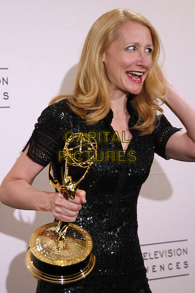 "PATRICIA CLARKSON.winner Outstanding Guest Actress in a Drama Series for ""Six Feet Under"".  .58th Annual Creative Arts Emmy Awards - Press Room held at the Shrine Auditorium, Los Angeles, California, USA..August 19th, 2006.Ref: ADM/ZL.half length award trophy black dress sequins.www.capitalpictures.com.sales@capitalpictures.com.©Zach Lipp/AdMedia/Capital Pictures."