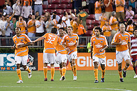 Houston Dynamo midfielder Ricardo Clark (13), defender Bobby Boswell (32) forward Brian Ching (25), midfielder Stuart Holden (22), forward Dwayne De Rosario (14), and defender Craig Waibel (16) celebrate a goal.   Houston Dynamo and FC Dallas played to a 1-1 tie at Robertson Stadium in Houston, TX on June 26, 2008.
