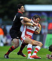 James Hook of Gloucester Rugby is tackled. European Rugby Challenge Cup Final, between Edinburgh Rugby and Gloucester Rugby on May 1, 2015 at the Twickenham Stoop in London, England. Photo by: Patrick Khachfe / Onside Images