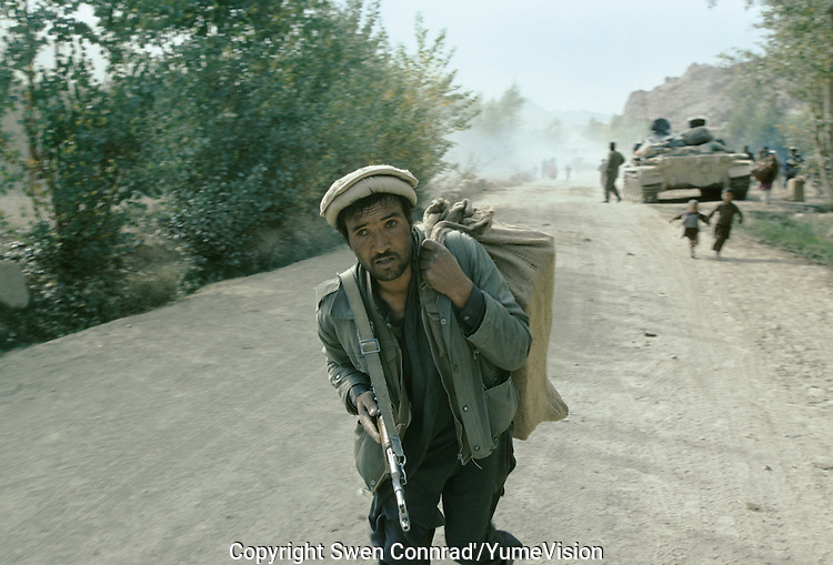 Army force of warlord Ahmad Shah Massoud (Jamiat-e-Islami and mercenary of Arakat-e-Islami) running away from the Karim Kalili Hezb-e-Wahdat Islami Hazara Mujahedins force in the Bamiyan valley in 1995..Mass exodus and hundreds of causality on the local population escaping the fight in Bamiyan.