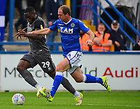 Lincoln City's John Akinde vies for possession with Macclesfield Town's Keith Lowe<br /> <br /> Photographer Andrew Vaughan/CameraSport<br /> <br /> The EFL Sky Bet League One - Macclesfield Town v Lincoln City - Saturday 15th September 2018 - Moss Rose - Macclesfield<br /> <br /> World Copyright &copy; 2018 CameraSport. All rights reserved. 43 Linden Ave. Countesthorpe. Leicester. England. LE8 5PG - Tel: +44 (0) 116 277 4147 - admin@camerasport.com - www.camerasport.com