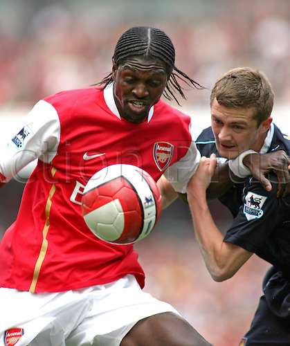7 April 2007: West Ham defender George McCartney competes for the ball with Emmanuel Adebayor during the Premiership game between Arsenal and West Ham United, played at The Emirates Stadium. West Ham won the match 1-0. Photo: Actionplus....070407 football soccer player