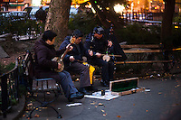 Residents play music at Manhattan's Chinatown in New York, Nov 11, 2013. VIEWpress/Eduardo Munoz Alvarez