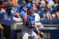 Umpire Matthew Czajak and Midland RockHounds catcher Bruce Maxwell (13) during a game against the Tulsa Drillers on June 3, 2015 at Oneok Field in Tulsa, Oklahoma.  Midland defeated Tulsa 5-3.  (Mike Janes/Four Seam Images)