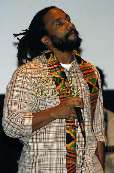 "KYMANI MARLEY.Premiere of the feature documentary ""Africa Unite"" at Walter Reade Theatre, Lincoln Center, as part of the New York African Film Festival, New York, New York, USA..April 7th, 2007.half length brown shirt stage microphone scarf beard facial hair .CAP/ADM/BL.©Bill Lyons/AdMedia/Capital Pictures *** Local Caption ***"