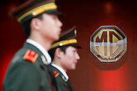 Chinese armed police soldiers stand in front of a large MG logo at the launching ceremony of the first Chinese built MG vehicles in Nanjing, China. The Chinese company is now in a position to take on Rover's assets and plan its future. It intended to relocate the engine plant and some car production plant to China but to retain some car production plant in the UK..27 Mar 2007