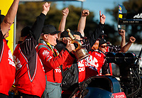 Feb 11, 2019; Pomona, CA, USA; NHRA top fuel driver Doug Kalitta celebrates with crew members after winning the Winternationals at Auto Club Raceway at Pomona. Mandatory Credit: Mark J. Rebilas-USA TODAY Sports