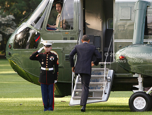 United States President Barack Obama departs the White House for a trip to Colorado and the West Coast on May 23, 2012..Credit: Dennis Brack / Pool via CNP