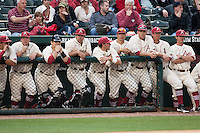 Arkansas Razorbacks watch the game from the dugout at Baum Stadium during the NCAA baseball game against the Alabama Crimson Tide on March 21, 2014 in Fayetteville, Arkansas.  The Alabama Crimson Tide defeated the Arkansas Razorbacks 17-9.  (William Purnell/Four Seam Images)