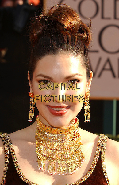 LAURA HARRING.60th Golden Globe Awards, Los Angeles, USA..January 19th, 2003.gold choker necklace, chunky, big hair headshot portrait jewellery.CAP/PL.©Phil Loftus/Capital Pictures