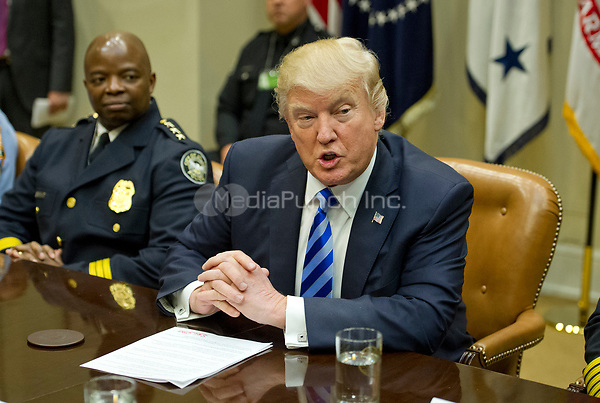 United States President Donald J. Trump makes remarks as he meets with the I-85 bridge first responders in the Roosevelt Room of the White House in Washington, DC on Thursday, April 13, 2017.<br /> Credit: Ron Sachs / Pool via CNP /MediaPunch