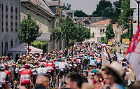 the peloton rolling through the town of  Réaumur<br /> <br /> Stage 2: Mouilleron-Saint-Germain > La Roche-sur-Yon (183km)<br /> <br /> Le Grand Départ 2018<br /> 105th Tour de France 2018<br /> ©kramon