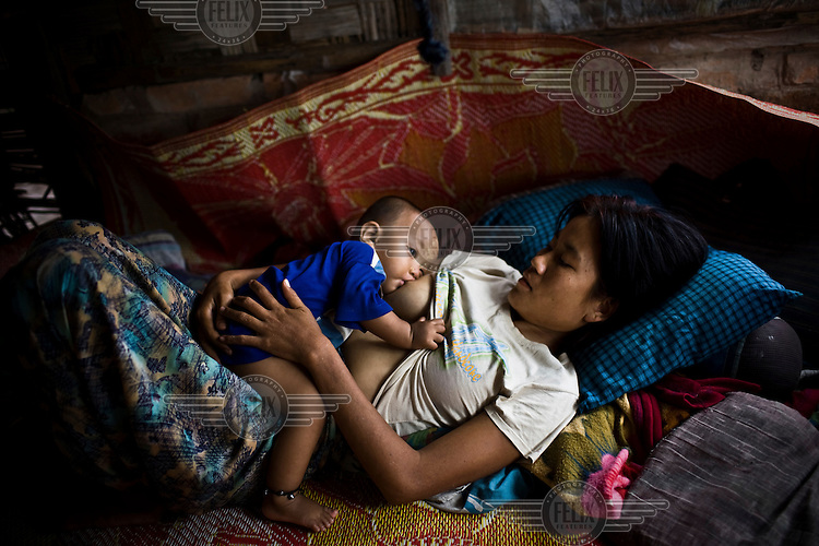 A mother breastfeeds her baby in the village of Kyauktan Yelapaye, devastated by Cyclone Nargis which hit the Irrawaddy Delta on 02/05/2008. No help reached the villagers for days.