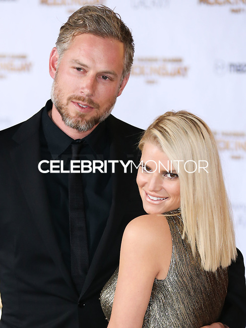 LOS ANGELES, CA, USA - NOVEMBER 17: Eric Johnson and Jessica Simpson arrive at the Los Angeles Premiere Of Lionsgate's 'The Hunger Games: Mockingjay, Part 1' held at Nokia Theatre L.A. Live on November 17, 2014 in Los Angeles, California, United States. (Photo by Xavier Collin/Celebrity Monitor)