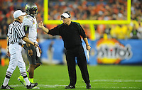 Jan 10, 2011; Glendale, AZ, USA; Oregon Ducks head coach Chip Kelly (right) argues with the official during the second quarter of the 2011 BCS National Championship game against the Auburn Tigers at University of Phoenix Stadium.  Mandatory Credit: Mark J. Rebilas-