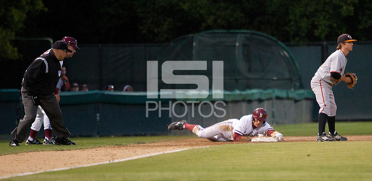 STANFORD, CA - April 12, 2011: Stephen Piscotty of Stanford baseball wraps the base as he slides into third from an errant pickoff play at first during Stanford's game against Pacific at Sunken Diamond. Stanford won 3-1.