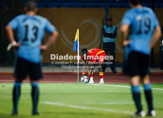 ISMAILIA, EGYPT - OCTOBER 2:  Abeiku Quansah of Ghana places the ball for a corner kick during the FIFA U-20 World Cup match against Uruguay at Ismailia Stadium on October 2, 2009 in Ismailia, Egypt.  Editorial use only.  Commercial use prohibited.  (Photograph by Jonathan P. Larsen)