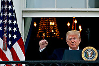 United States President Donald J. Trump arrives to speak from the Blue Room Balcony of the White House during a Rolling to Remember ceremony honoring the nation's veterans and prisoners of war/missing in action (POW/MIA) in Washington, D.C., U.S., on Friday, May 22, 2020. Trump didn't wear a face mask during most of his tour of Ford Motor Co.'s ventilator facility Thursday, defying the automaker's policies and seeking to portray an image of normalcy even as American coronavirus deaths approach 100,000. <br /> Credit: Andrew Harrer / Pool via CNP/AdMedia
