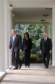 United States President George W. Bush, left, US Secretary of State Condoleezza Rice, center and US Secretary of Defense Robert Gates, right, make their way to the Rose garden when Bush spoke on the Russian-Georgian conflict in South Ossetia in the Rose Garden at the White House in Washington on August 13, 2008. Bush announced he will be sending Secretary of State Condoleezza Rice to the Georgian capitol of Tbilisi. <br /> Credit: Kevin Dietsch / CNP