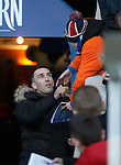 An emotional Fernando Ricksen signs autographs for a young fan as the ill ex-player walks out onto the park at half-time
