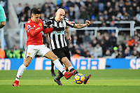 Alexis Sanchez of Manchester United battles with Jonjo Shelvey of Newcastle United during Newcastle United vs Manchester United, Premier League Football at St. James' Park on 11th February 2018