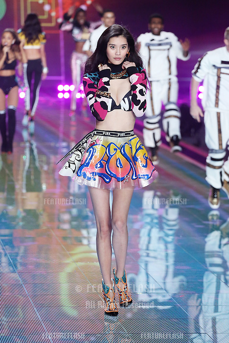 Ming Xi on the runway at the Victoria's Secret Fashion Show 2014 London held at Earl's Court, London. 02/12/2014 Picture by: James Smith / Featureflash