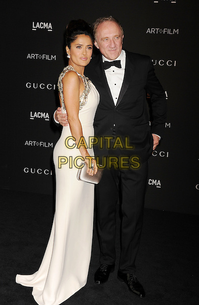 LOS ANGELES, CA - NOVEMBER 01: Actress Salma Hayek (L) and Francois-Henri Pinault attend the 2014 LACMA Art + Film Gala honoring Barbara Kruger and Quentin Tarantino presented by Gucci at LACMA on November 1, 2014 in Los Angeles, California.<br /> CAP/ROT/TM<br /> &copy;Tony Michaels/Roth Stock/Capital Pictures