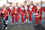 Santas get warmed up before the Santa Run at Scotch Hall. Photo: Colin Bell/pressphotos.ie