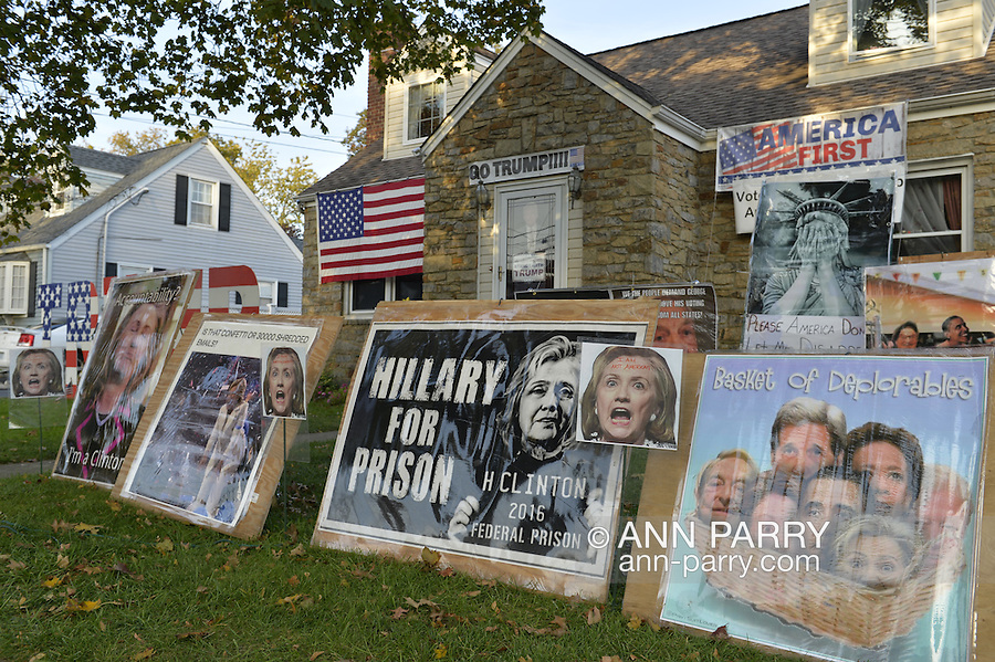 """Bellmore, New York, USA. November 2, 2016. Political signs against Democratic presidential candidate Hillary Clinton are in front yard Halloween display of Eileen Fuscaldo, a Donald Trump supporter. A """"Basket of Deplorables"""" photo has heads of Clinton, Pres. Obama and others supporting her.  """"Hillary for Prison"""" is another sign."""