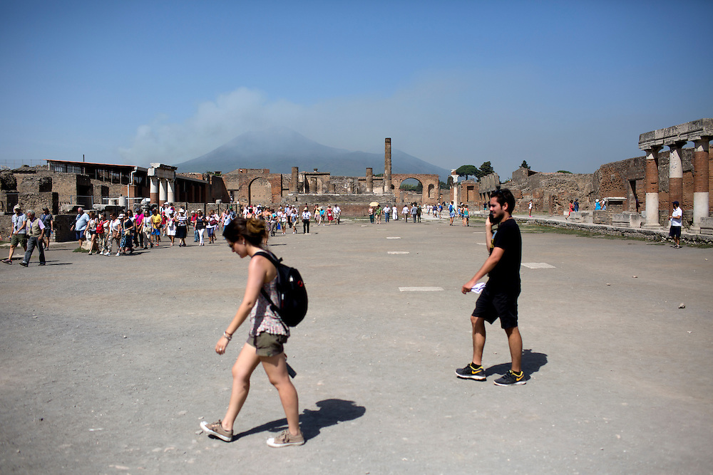 Mount Vesuvius looms over the forum of the ancient city of Pompeii on Friday, Sept. 18, 2015, in Pompeii, Italy. The city of Pompeii was destroyed when the nearby volcano erupted on August 24, AD 79. The town and its residents were buried and forgotten until the ruins were discovered and eventually excavated hundreds of years later. The ruins are one of Italy's top tourist attractions today. (Photo by James Brosher)