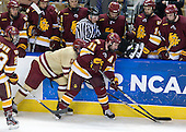 Linesman does a great job staying out of the way of a pair of elevens - Pat Mullane (BC - 11), Travis Oleksuk (Duluth - 11) - The Boston College Eagles defeated the University of Minnesota Duluth Bulldogs 4-0 to win the NCAA Northeast Regional on Sunday, March 25, 2012, at the DCU Center in Worcester, Massachusetts.