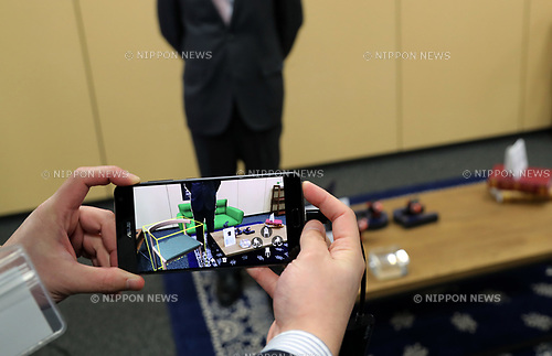 "April 13, 2017, Tokyo, Japan - Taiwan's electronic maker ASUS introduces its latest smart phone ""ZenFone AR"" at a press preview in Tokyo on Thursday, April 13, 2017.  The world's first Tango and Daydream AR and VR ready smart phone displays virtual image against a photo on a 5.7-inch OLED screen using augmented reality (AR) technology. It will go on sale this summer with a price of 99,800yen.   (Photo by Yoshio Tsunoda/AFLO) LwX -ytd-"