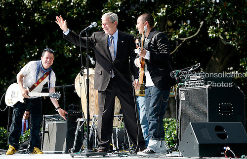 United States President George W. Bush greets the Colombian band,  Andres Cabas and his musicians,after they performed during the Hispanic Heritage Month celebration on the South Lawn of the White House, in Washington DC, on October 09, 2008.<br /> Credit: Aude Guerrucci / Pool via CNP