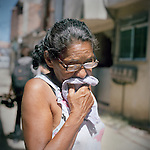Thirty-year resident Maria Estele, of Largo do Tanque, was compensated only $7,000 usd in Rio de Janeiro's West Zone, to make room for the Transcarioca Highway, that will eventually be built to accommodate the Olympics, in Rio de Janeiro, Brazil, on Monday, Feb. 25, 2013. <br /> <br /> In less than 2 weeks, 54 houses were demolished with sledgehammers and bulldozers. In under 2 weeks, 54 houses were demolished and hundreds of residents left to fend for themselves. The City assessor sent to handle negotiations told residents not to speak with one another or seek legal advice otherwise he would reduce settlement offers. Many residents agreed to compensations, around R$7000 (US$3500). Most residents cannot afford to buy a plot of land with that compensation and will be forced to rent kitchenettes, at less than 20m2. As established in the Brazilian Constitution, and in accordance with local legislation (the Organic Municipal Law), the duration of residents' life in the area gave them legal rights to the homes, while compensation should allow them to attain an equal situation elsewhere. <br /> <br /> The west zone, located west of downtown and beach neighborhoods is often overlooked and is widely known to be run by militia groups, who are former and current police and firefighter personnel that run extortion rings to monopolies.