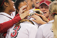STANFORD, CA - April 15, 2011:  Ashley Hansen is greeted by teammates at home base after her solo home run in Stanford's 7-0 victory over Oregon State at Stanford, California on April 15, 2011.
