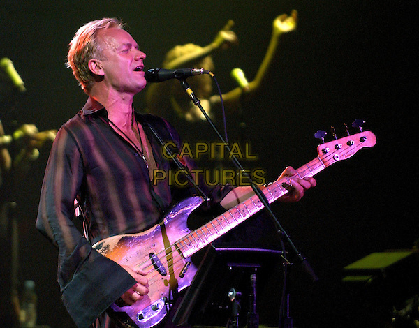 STING.performs live as part of his Sacred Love Tour 2004 at The Pantages Theatre in Hollywood, California .10 February 2004   .*UK Sales Only*                                                .music, live, stage, singing, playing guitar, concert, gig.www.capitalpictures.com.sales@capitalpictures.com.©Capital Pictures.