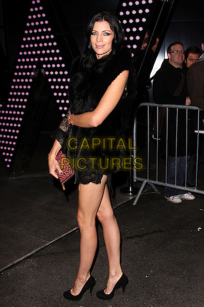 LIBERTY ROSS.Vogue.com's 15th Anniversary Party at W London Leicester Square, London, England. .February 17th, 2011.full length black dress clutch bag pink.CAP/AH.©Adam Houghton/Capital Pictures.