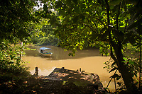 Landscape with view inside of a rainforest and a boat on the San Juan River, Indio Maiz Biological Reserve, Nicaragua