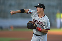 Third baseman Josh Jung (15) of the Hickory Crawdads warms up before a game against the Columbia Fireflies on Wednesday, August 28, 2019, at Segra Park in Columbia, South Carolina. Hickory won, 7-0. (Tom Priddy/Four Seam Images)